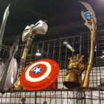 Comic Con Revolution Chicago display of MCU weapons